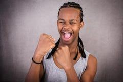Expressieve zwarte mens met omhoog vuisten Stock Foto