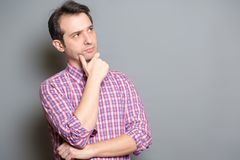 Portrait of thoughtful handsome man in casual style thinking royalty free stock photos