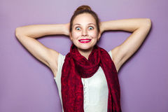 Expressing positive emotions, smile with big eyes and teeth. Surprised Woman. Young emotional beauty with collected hair and red scarf looking excited, crossed Stock Images