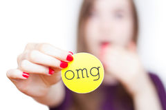 Expressing surprised, shocked reaction. Close-up of girl reacting surprised holding up an omg sign isolated on white with faded background Stock Photography