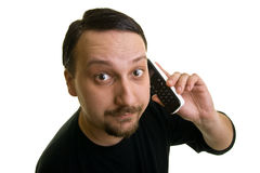 Expression. Surprised man on the phone Royalty Free Stock Images