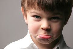 Expression. A child with negative expression Royalty Free Stock Photography