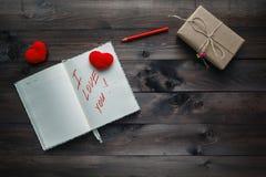 Expression au sujet de l'amour écrit dans le carnet Photos libres de droits