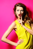 Expression. Beautiful fashion model in bright yellow dress posing with her long hair. Beauty, fashion concept. Hair, healthy hair Stock Photo