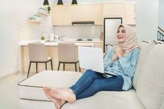expression of beautiful young woman wearing hijab watching satis