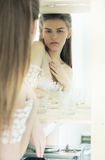 Expression. Candid Genuine Pensive Woman Reflects in Mirror Royalty Free Stock Images