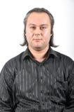Expression du visage aux cheveux longs d'homme Photographie stock