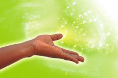 EXPRESSION OF ENERGY. Male hand giving healing energy by a vibrational frequency Stock Image