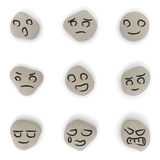 Expression. Face painted on stone. Various expressions. Look laugh. People angry. Stone nine. Face simple. Picture cry Royalty Free Stock Photography