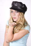 Expression girl with black hat blowing kiss Stock Images