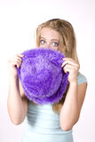 Expression girl looking over purple hat Stock Images