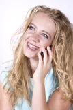 Expression girl on phone happy Royalty Free Stock Photo