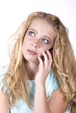 Expression girl on phone thinking Royalty Free Stock Photo