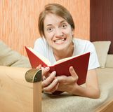 Expression girl  reading on sofa Stock Photo