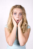 Expression girl surprised hands on face Royalty Free Stock Image