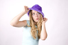 Expression girl thinking with purple hat Royalty Free Stock Photography