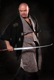 The expression man in the image of a samurai  with sword in hand Stock Photos