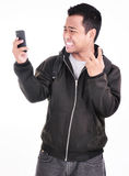 The expression of a man who does not like the phone Stock Images