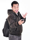The expression of a man who was surprised after phone Stock Photos