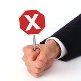 Expression of No. Holding a cross road sign mean reject Royalty Free Stock Photography