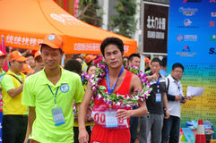Expression of pity. Runner-up of athletes the expression of regret.Half international marathon in fushui county in yunnan province in China, time: on September Stock Image