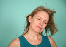 Expression of pleasure on mature woman Stock Photography