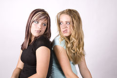 Expression two girls snarling Royalty Free Stock Photo