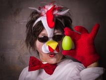 Surprised woman with egg in chicken costume . Expression woman in chicken costume with egg. Which came first - Chicken or Egg Royalty Free Stock Photos