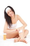 Expression woman depilating her legs Royalty Free Stock Photography