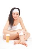 Expression woman depilating legs Stock Images