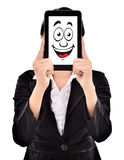 Expression of young businesswoman smiles in tablets Stock Images