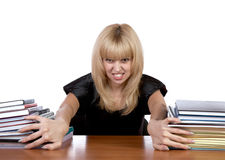 The expressional girl moves apart piles of papers Royalty Free Stock Photos