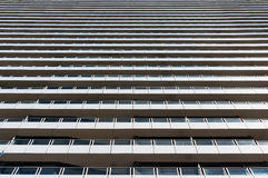 Expressionless, modern architechture building. Contemporary modern building exterior of expressionless, standardizated layers of windows and balconies going Stock Photos