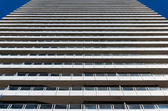 Expressionless, standardized modern architecture building. Contemporary modern building exterior of expressionless, standardized layers of windows and balconies Stock Images