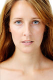 Expressionless woman. Close up portrait of a redhead caucasian woman, with barely any make up Royalty Free Stock Images