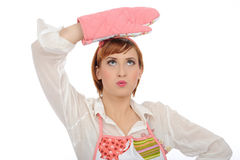 Expressions.Beautiful cooking woman in apron Stock Photography