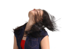 Expressions Carefree Girl. Asian girl slinging her hair, with motion blur royalty free stock photo