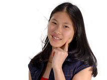 Expressions, Cheeky Girl. Happy Asian girl playfully looking cheeky stock photo