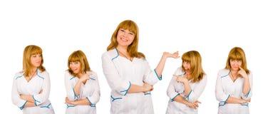 Expressions comiques sur un joli visage d'infirmière Images libres de droits