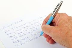 Expressions d'amour d'écriture sur un papier avec un stylo Photos libres de droits