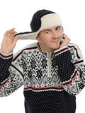 Expressions.Funny winter man in warm hat listening Royalty Free Stock Photography