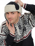 Expressions.Funny winter man in warm hat listening Stock Photo