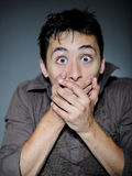 Expressions. Handsome young man feeling fear Stock Photography