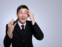 Expressions. happy business man looking up Royalty Free Stock Photography