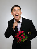 Expressions.Happy romantic husband holding rose Stock Photo
