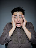 Expressions. man is terrified and feeling fear Royalty Free Stock Photo