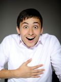 Expressions man in white shirt surprised Royalty Free Stock Photos