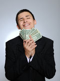 Expressions Young business man with money Royalty Free Stock Photography