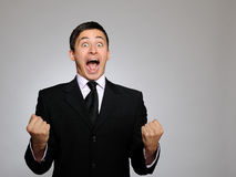 Expressions. Young business man screaming Stock Image