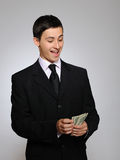 Expressions.Young handsome business man with money Royalty Free Stock Images